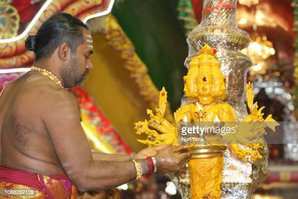 Tamil Hindu priests perform a special abhishekam honouring Lord Murugan during the Sooran Por Festival at a Tamil Hindu temple in Ontario Canada on...
