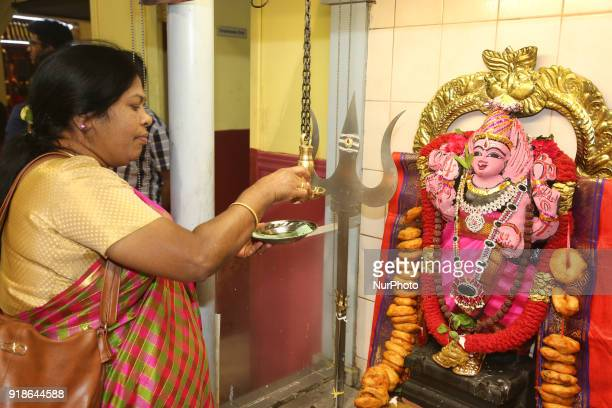 Tamil Hindu woman lights a lamp at the shrine of Lord Shiva during the Maha Shivratri festival at a Tamil Hindu temple in Ontario Canada on February...