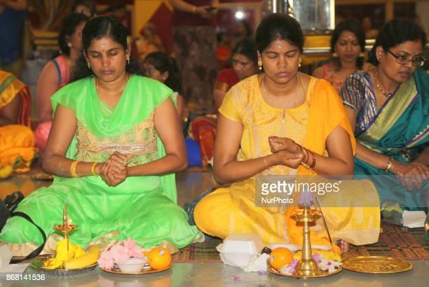 Tamil Hindu women participate in special prayers during Varalaxmi Pooja at a Tamil Hindu temple in Toronto Ontario Canada Varalaxmi Pooja is...