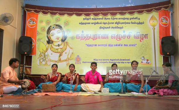 Tamil Hindu youth perform devotional Carnatic songs during the Ther Festival at the Nallur Kandaswamy Kovil in Jaffna Sri Lanka on 21 August 2017...