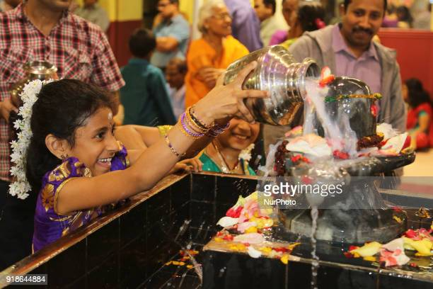 Tamil Hindus offers prayers by pouring milk over a Shiva Lingam during the Maha Shivratri festival at a Tamil Hindu temple in Ontario Canada on...