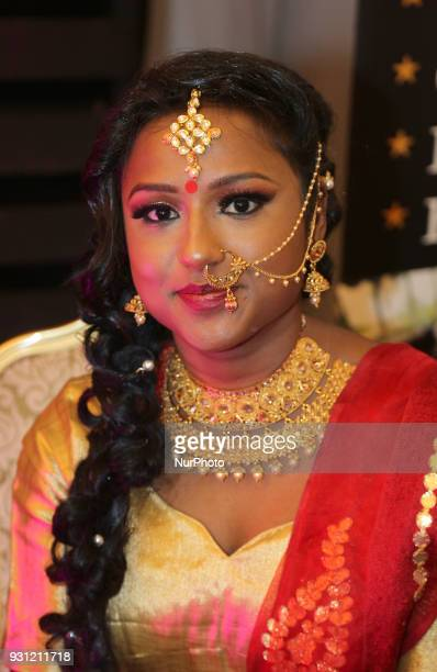 Tamil model showcases a designer outfit during a South Indian fashion show in Scarborough Ontario Canada