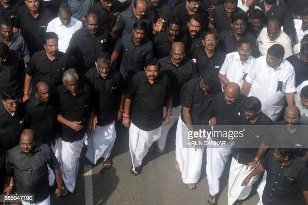 Tamil Nadu Chief Minister Edappadi Palanisamy along with supporters of the All India Anna Dravida Munnetra Kazhagam party take part in a procession...