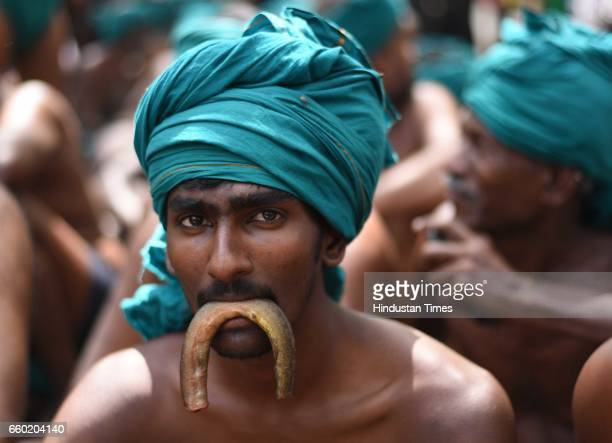 Tamil Nadu farmers enacts eating a snake as a form of protest demanding that their loans with nationalised banks be written off owing to loss of crop...