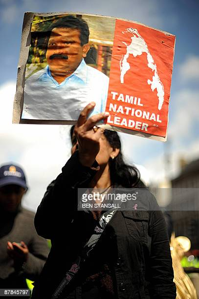 A Tamil protestor holds and image of the leader of the Tamil Tigers Velupillai Prabhakaran outside parliament in central London on May 19 2009...