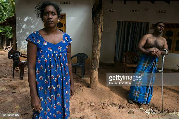 Tamil War Victim Ravi Chandran ¨ and his wife Pusparani stand outside their house in Mullaitivu Sri Lanka July 8 2013 War's end has unleashed...