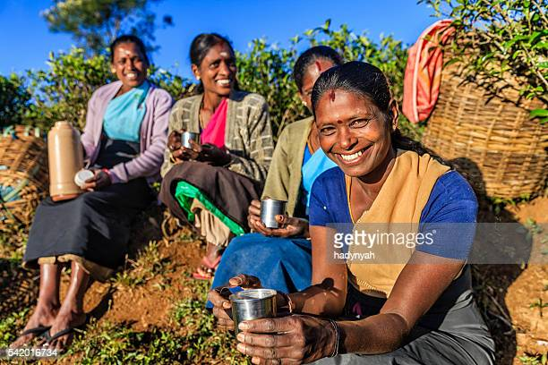 Tamil women drinking fresh tea on plantation, Ceylon