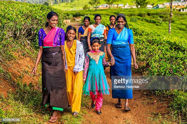 Tamil women walking with their children, Nuwara Eliya, Ceylon