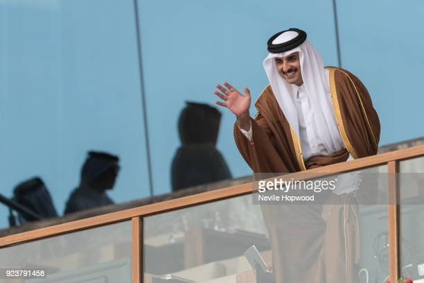 H Tamim Bin Hamad Al Thani Emir of Qatar waves to racegoers before talking his seat at Al Rayyan Racecourse on February 24 2018 in Doha Qatar