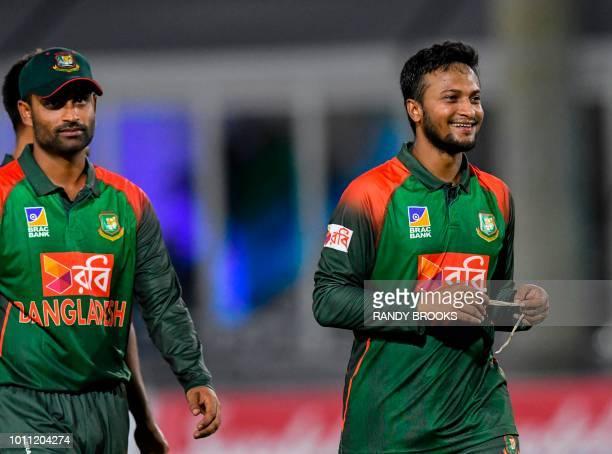 Tamim Iqbal and Shakib Al Hasan of Bangladesh react at the end of the 2nd T20i match between West Indies and Bangladesh at Central Broward Regional...