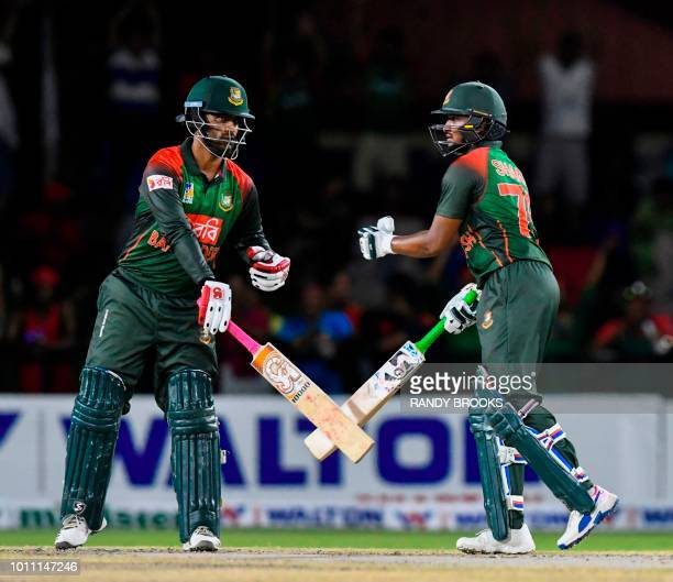 Tamim Iqbal and Shakib Al Hasan of Bangladesh speak during the 2nd T20i match between West Indies and Bangladesh at Central Broward Regional Park...