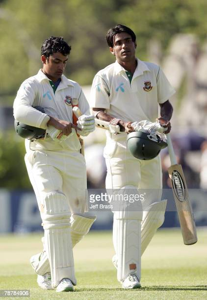 Tamim Iqbal and Zunaed Siddique of Bangladesh leave the field at the end of play on day two of the the First Test match between New Zealand and...