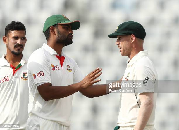 Tamim Iqbal Khan of Bangladesh and David Warner of Australia exchange words during day three of the First Test match between Bangladesh and Australia...