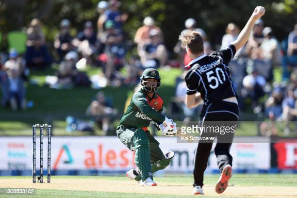 Tamim Iqbal Khan of Bangladesh reacts as James Neesham of New Zealand fields the ball during game two of the One Day International series between New...