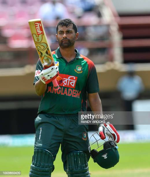 Tamim Iqbal of Bangladesh celebrates his century during the 1st ODI match between West Indies and Bangladesh at Guyana National Stadium Providence...