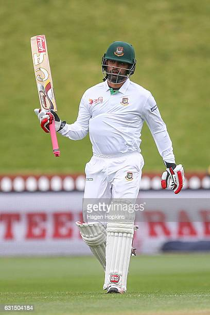 Tamim Iqbal of Bangladesh celebrates his half century during day one of the First Test match between New Zealand and Bangladesh at Basin Reserve on...
