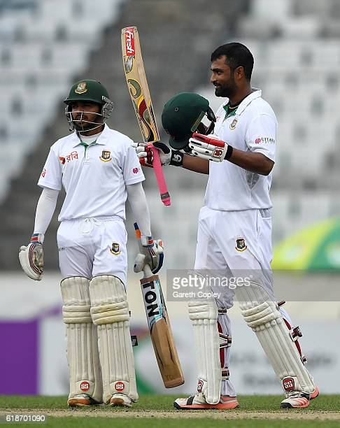 Tamim Iqbal of Bangladesh celebrates with Mominul Haque after reaching his century during the first day of the 2nd Test match between Bangladesh and...