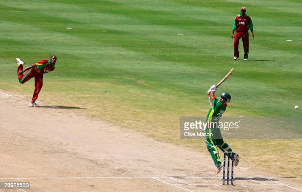 Tamim Iqbal of Bangladesh hits out off the bowling of Daren Powell of West Indies during the ICC Cricket World Cup Super Eights match between West...