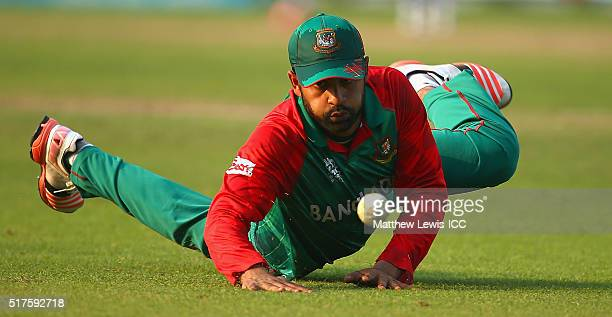 Tamim Iqbal of Bangladesh loos tostop the ball during the ICC World Twenty20 India 2016 match between Bangladesh and New Zealand at Eden Gardens on...