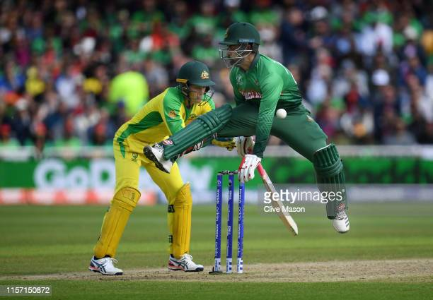 Tamim Iqbal of Bangladesh makes his ground but is hit by the ball during the Group Stage match of the ICC Cricket World Cup 2019 between Australia...