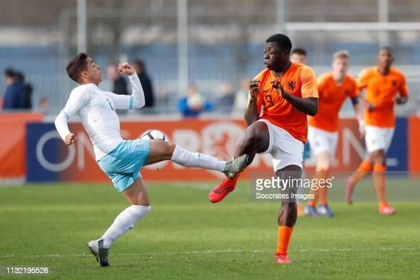 Tamir Nes Arbel of Israel U17 Brian Brobbey of Holland U17 during the match between Holland U17 v Israel U17 at the Sportpark Zegersloot on March 23...