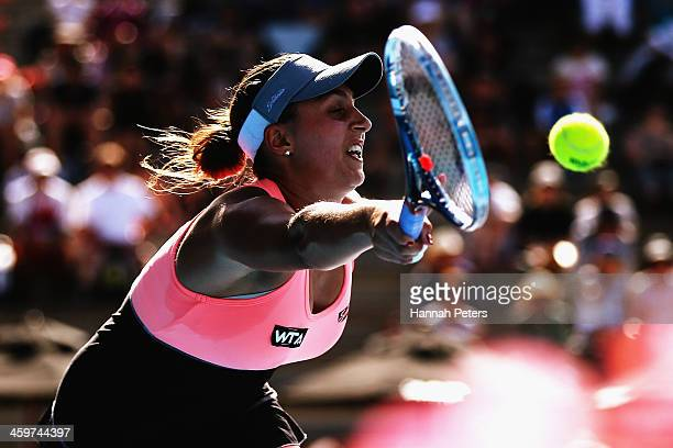 Tamira Paszek of Austria plays a forehand against Jamie Hampton of the USA during day one of the ASB Classic at ASB Tennis Centre on December 30,...