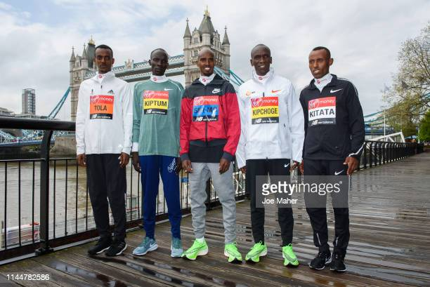 Tamirat Tola Abraham Kiptum Sir Mo Farah Eliud Kipchoge and Shura Kitata attends the Elite men's photocall ahead of Sunday's London Marathon at The...