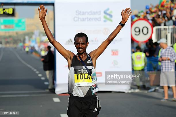 Tamirat Tola of Ethiopia gestures after he won Elite Men's Standard Chartered Dubai Marathon 2017 in Dubai United Arab Emirates on January 20 2017