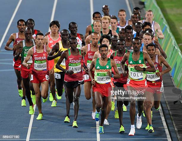 Tamirat Tola of Ethiopia leads at the start of the Men's 10000m on Day 8 of the Rio 2016 Olympic Games at the Olympic Stadium on August 13 2016 in...