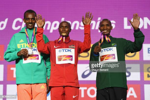 Tamirat Tola of Ethiopia poses with the silver medal Geoffrey Kipkorir Kirui of Kenya poses with the gold medal and Alphonce Felix Simbu of Tanzania...