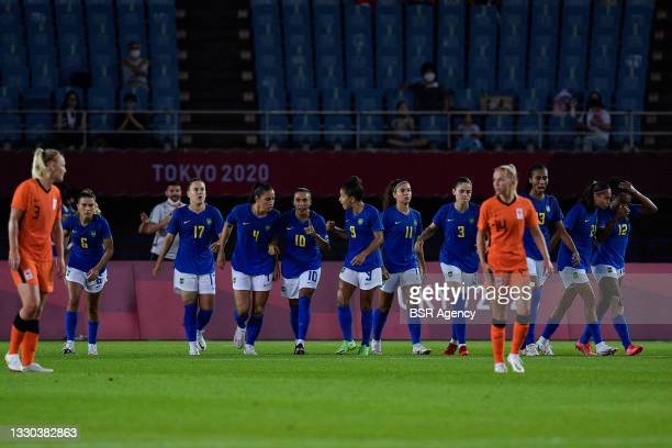 Tamires of Brazil, Andressinha of Brazil, Marta of Brazil, players of Brazil celebrate after scoring their teams second goal during the Tokyo 2020...
