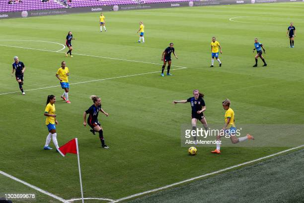 Tamires of Brazil attempts a shot past Rose Lavelle of the United States during the SheBelieves Cup at Exploria Stadium on February 21, 2021 in...