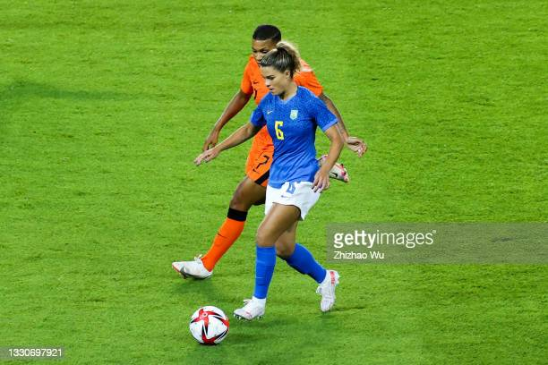 Tamires of Brazil controls the ball during the Women's First Round Group F match on day one of the Tokyo 2020 Olympic Games at Miyagi Stadium on July...