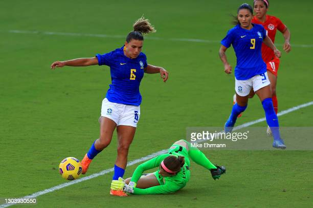 Tamires of Brazil is stopped by Stephanie Labbe of Canada during the SheBelieves Cup at Exploria Stadium on February 24, 2021 in Orlando, Florida.