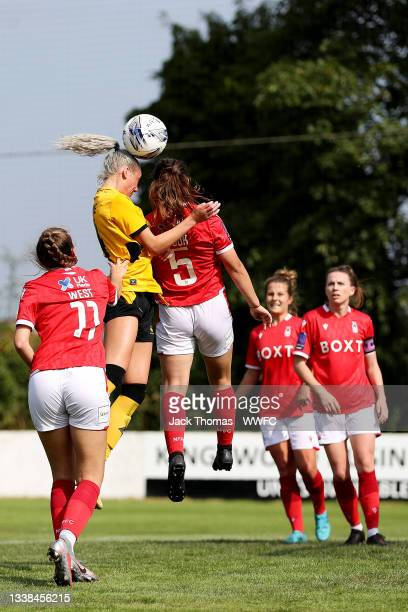 Tammi George of Wolverhampton Wanderers headers the ball over Olivia Cook of Nottingham Forest Women during the FAWNL Northern Premier Division match...