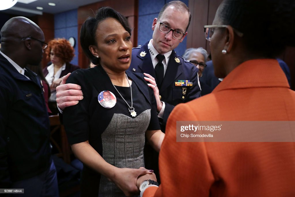 Tammi Ramzziddin, widow of Prince GeorgeÕs County Police Cpl. Mujahid Ramzziddin (C) talks with Kim Bose, mother of murdered Hampton University student Joseph Bose, and Prince George's County Police Chief Hank Stawinski (2nd R) following a meeting with U.S. Senate Democrats in the visitors center at the U.S. Capitol March 7, 2018 in Washington, DC. Senate Democrats called the meeting a 'hearing' and invited the parents of young gun violence victims from Florida, Virginia and Connecticut; law enforcement officials; students and teachers.