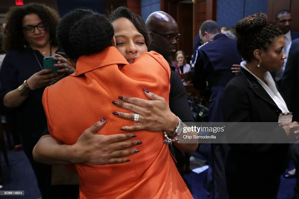 Tammi Ramzziddin (C), widow of Prince GeorgeÕs County Police Cpl. Mujahid Ramzziddin, embraces Kim Bose, mother of murdered Hampton University student Joseph Bose, following a meeting with U.S. Senate Democrats in the visitors center at the U.S. Capitol March 7, 2018 in Washington, DC. Senate Democrats called the meeting to hear from people who they said were missing from the debate on guns, including the parents of young gun violence victims from Florida, Virginia and Connecticut; law enforcement officials; students and teachers.