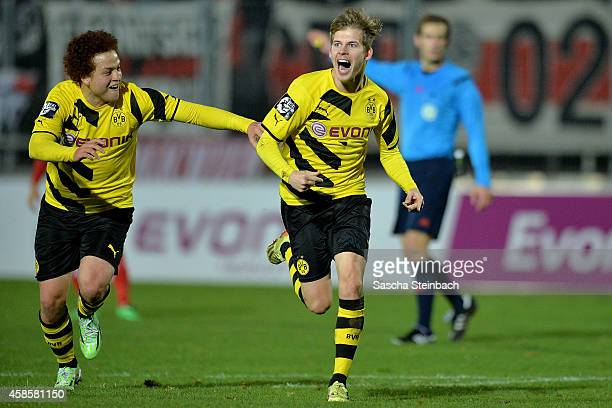 Tammo Harder of Dortmund celebrates after scoring his team's third goal with team mate Mustafa Amini during the 3 Liga match between Borussia...