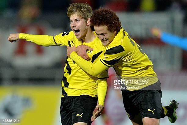 Tammo Harder of Dortmund celebrates after scoring his team's third goal with team mate Mustafa Amini during the 3 Liga match between Borussia...