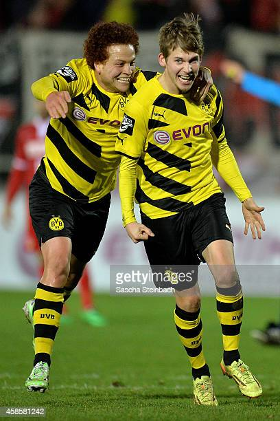 Tammo Harder of Dortmund celebrates with team mate Mustafa Amini after scoring his team's third goal during the 3 Liga match between Borussia...
