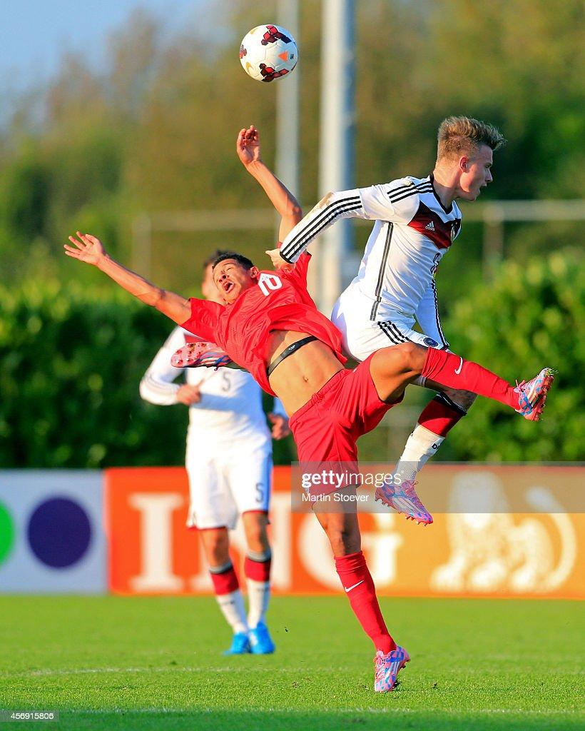 Tammo Harder of U20 Germany challenges Callum Robinson of U20 England during the match between U20 Germany v U20 England at Sportpark Skoatterwald on October 9, 2014 in Heerenveen, Netherlands.