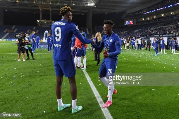 Tammy Abraham and Callum Hudson-Odoi of Chelsea celebrate winning the Champions League following the UEFA Champions League Final between Manchester...