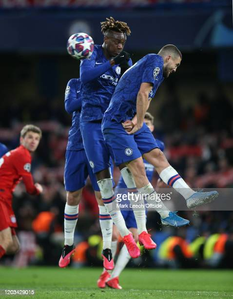 Tammy Abraham and Mateo Kovacic of Chelsea jump in a defensive wall to try to block a free kick during the UEFA Champions League round of 16 first...