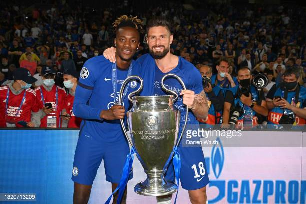 Tammy Abraham and Olivier Giroud of Chelsea pose with the Champions League Trophy following their team's victory in the UEFA Champions League Final...