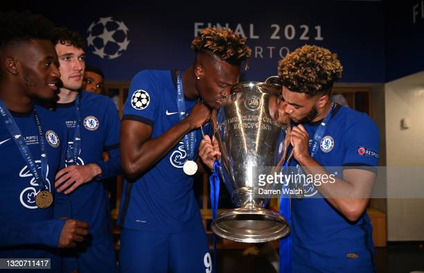 Tammy Abraham and Reece James of Chelsea kiss the trophy inside the dressing room following victory during the UEFA Champions League Final between...