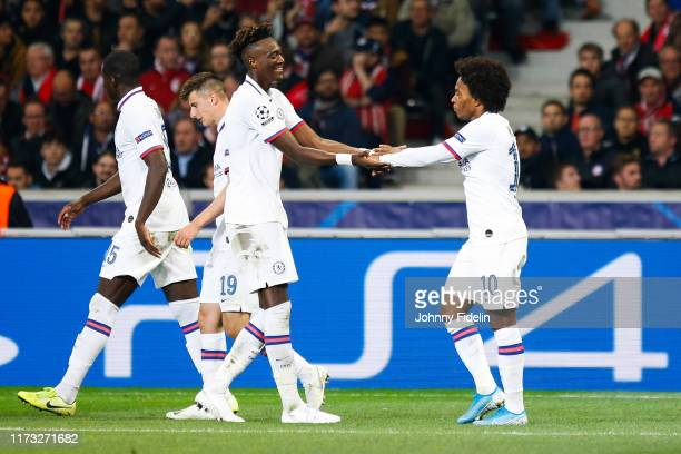 Tammy ABRAHAM and WILLIAN of Chelsea celebrate his goal during the UEFA Champions League match between Lille and Chelsea at Stade Pierre Mauroy on...
