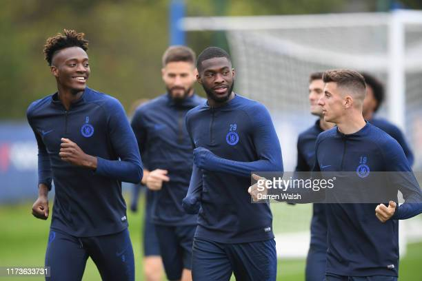 Tammy Abraham Fikayo Tomori and Mason Mount of Chelsea during a training session at Chelsea Training Ground on October 4 2019 in Cobham England