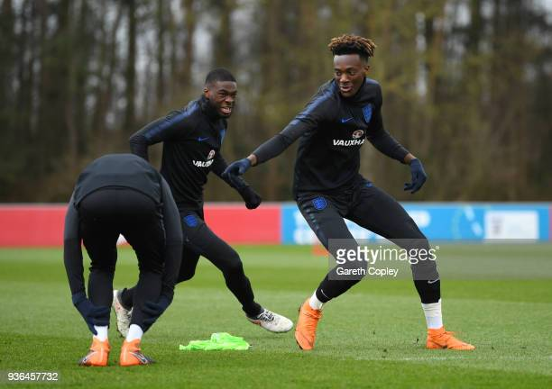 Tammy Abraham is chased by Fikayo Tomori during an England U21 training session at St Georges Park on March 22 2018 in BurtonuponTrent England...