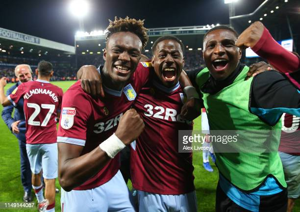 Tammy Abraham Keinan Davis and Kortney Hause of Aston Villa celebrate victory in the penalty shoot out after the Sky Bet Championship Playoff semi...