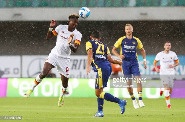 Tammy Abraham of AS Roma battles for possession with Koray Guenter of Hellas Verona during the Serie A match between Hellas and AS Roma at Stadio...